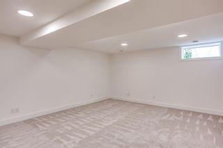 Photo 34: 7411 7 Street SW in Calgary: Kingsland Detached for sale : MLS®# A1021335