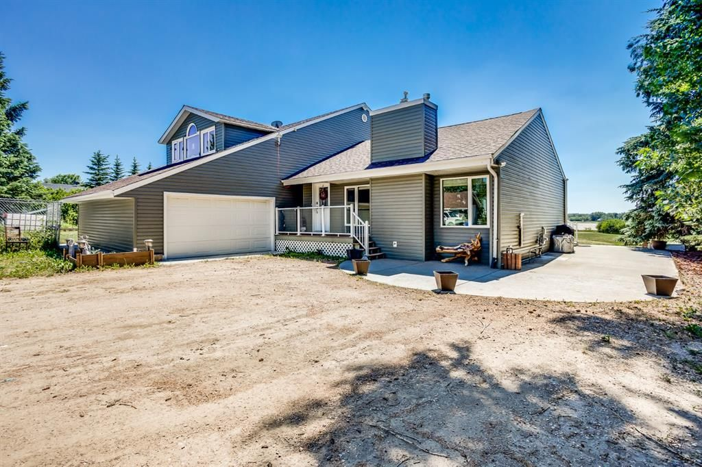 Main Photo: 409 Shore Drive in Rural Rocky View County: Rural Rocky View MD Detached for sale : MLS®# A1126104
