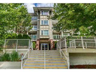 """Photo 1: 108 2373 ATKINS Avenue in Port Coquitlam: Central Pt Coquitlam Condo for sale in """"CARMANDY"""" : MLS®# V1136914"""