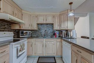 Photo 15: 7 Strandell Crescent SW in Calgary: Strathcona Park Detached for sale : MLS®# A1150531