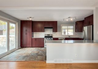 Photo 5: 340 Acadia Drive SE in Calgary: Acadia Detached for sale : MLS®# A1149991
