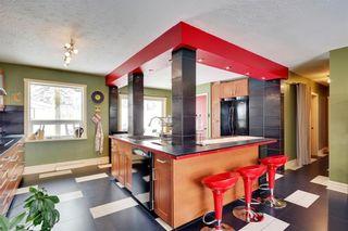 Photo 6: 49 MEADOWVIEW RD SW in Calgary: Meadowlark Park House for sale : MLS®# C4104032