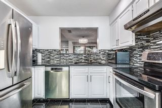 """Photo 18: 4687 GARDEN GROVE Drive in Burnaby: Greentree Village Townhouse for sale in """"Greentree Village"""" (Burnaby South)  : MLS®# R2608954"""