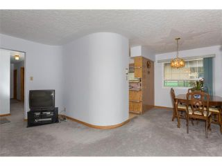 Photo 10: 1011 THORNEYCROFT Drive NW in Calgary: Thorncliffe House for sale : MLS®# C4026935
