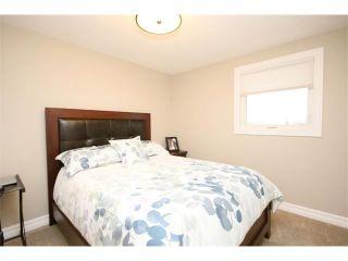 Photo 35: 156 GLENEAGLES Close: Cochrane House for sale : MLS®# C4018066