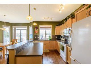 Photo 7: 107 DRAKE LANDING Place: Okotoks House for sale : MLS®# C4057277