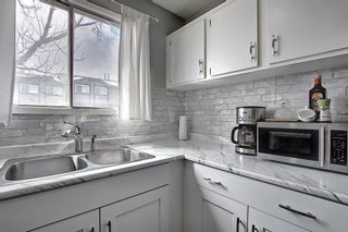 Photo 10: 104 7172 Coach Hill Road SW in Calgary: Coach Hill Row/Townhouse for sale : MLS®# A1097069