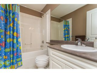 """Photo 14: 36014 STEPHEN LEACOCK Drive in Abbotsford: Abbotsford East House for sale in """"Auguston"""" : MLS®# R2158751"""