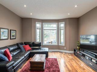 Photo 4: 40 ROSSDALE Road SW in Calgary: Rosscarrock Semi Detached for sale : MLS®# A1046518
