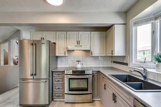 Photo 17: 100 Patina Park SW in Calgary: Patterson Row/Townhouse for sale : MLS®# A1130251