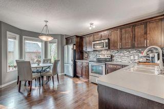 Photo 8: 61 Auburn Springs Boulevard SE in Calgary: Auburn Bay Semi Detached for sale : MLS®# A1135621