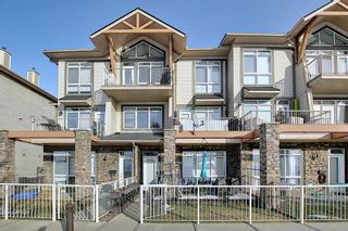 Photo 1: 19 117 Rockyledge View NW in Calgary: Rocky Ridge Row/Townhouse for sale : MLS®# A1061525