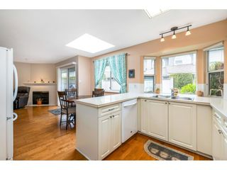"""Photo 6: 6139 W BOUNDARY Drive in Surrey: Panorama Ridge Townhouse for sale in """"LAKEWOOD GARDENS"""" : MLS®# R2452648"""