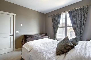 Photo 19: 47 WEST SPRINGS Lane SW in Calgary: West Springs Row/Townhouse for sale : MLS®# A1039919