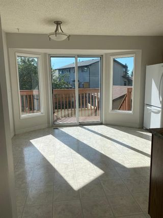 Photo 5: 554 STRATHCONA Drive SW in Calgary: Strathcona Park Semi Detached for sale : MLS®# A1020759