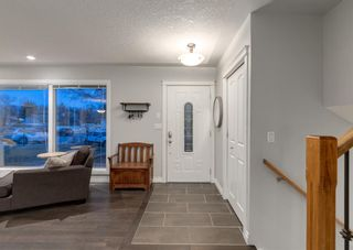 Photo 2: 563 Woodpark Crescent SW in Calgary: Woodlands Detached for sale : MLS®# A1095098