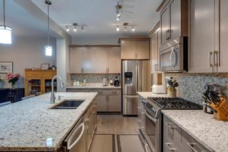 Photo 4: 157 Sunset Point: Cochrane Row/Townhouse for sale : MLS®# A1132458