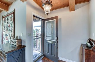 Photo 4: 2607 Canmore Road NW in Calgary: Banff Trail Semi Detached for sale : MLS®# A1146010