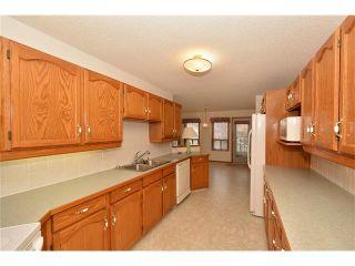 Photo 17: 12 WEST COPITHORNE Place: Cochrane House for sale : MLS®# C4049219