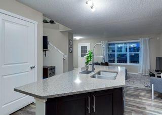 Photo 11: 40 EVANSRIDGE Court NW in Calgary: Evanston Row/Townhouse for sale : MLS®# A1095762