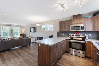Photo 12: 60 Sunset Road: Cochrane Row/Townhouse for sale : MLS®# A1128537