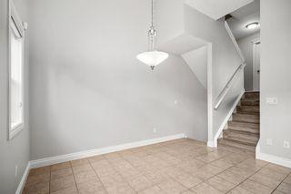Photo 12: 5 Cougar Ridge Mews SW in Calgary: Cougar Ridge Row/Townhouse for sale : MLS®# A1105171