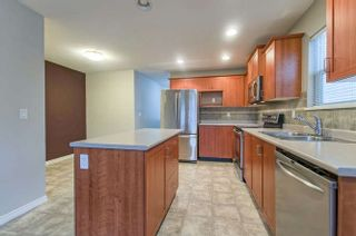 Photo 4: 415 3000 RIVERBEND DRIVE in Coquitlam: Coquitlam East House for sale : MLS®# R2243538