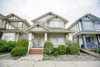 """Photo 1: 18960 72 Avenue in Surrey: Clayton House for sale in """"Clayton"""" (Cloverdale)  : MLS®# R2209332"""
