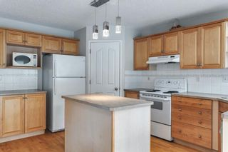 Photo 12: 7854 Springbank Way SW in Calgary: Springbank Hill Detached for sale : MLS®# A1142392