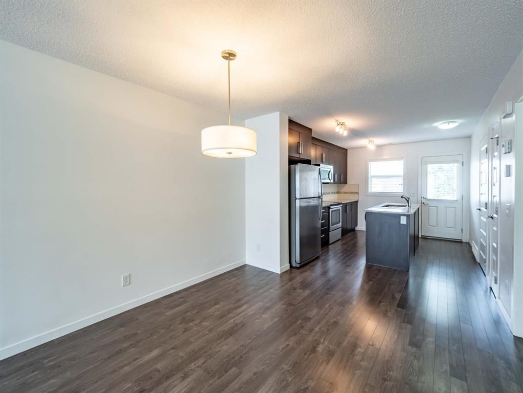Photo 5: Photos: 544 Mckenzie Towne Close SE in Calgary: McKenzie Towne Row/Townhouse for sale : MLS®# A1128660