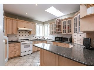 Photo 9: 7687 MARY AVE - LISTED BY SUTTON CENTRE REALTY in Burnaby: Edmonds BE House for sale (Burnaby East)  : MLS®# V1126167