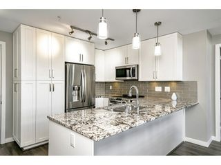 """Photo 8: 410 6490 194 Street in Surrey: Cloverdale BC Condo for sale in """"WATERSTONE"""" (Cloverdale)  : MLS®# R2535628"""