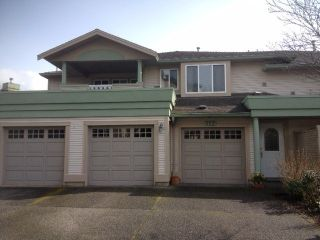 """Photo 1: 112 13888 70TH Avenue in Surrey: East Newton Townhouse for sale in """"Chelsea Gardens"""" : MLS®# F1305021"""