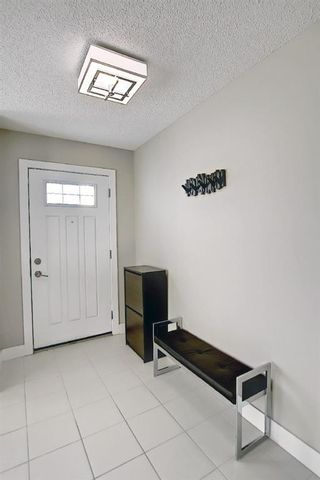 Photo 3: 442 Nolan Hill Boulevard NW in Calgary: Nolan Hill Row/Townhouse for sale : MLS®# A1073162