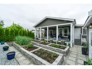 "Photo 1: 205 3665 244 Street in Langley: Otter District Manufactured Home for sale in ""Langley Grove Estates"" : MLS®# R2372975"