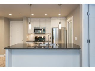 """Photo 6: 104 2238 WHATCOM Road in Abbotsford: Abbotsford East Condo for sale in """"Waterleaf"""" : MLS®# R2260128"""