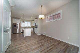 Photo 4: 8 HERITAGE Boulevard: Cochrane Detached for sale : MLS®# C4203081