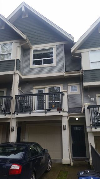 """Photo 1: 28 15065 58 Avenue in Surrey: Sullivan Station Townhouse for sale in """"SPRINGHILL"""" : MLS®# R2026880"""