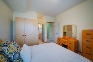 Photo 14: 101 72 Quigley Drive: Cochrane Apartment for sale : MLS®# A1091486