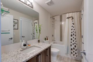 Photo 21: 309 8531 8A Avenue SW in Calgary: West Springs Apartment for sale : MLS®# A1121535
