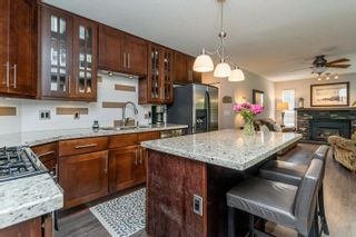 Photo 11: 23 FLAVELLE Drive in Port Moody: Barber Street House for sale : MLS®# R2599334