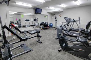 Photo 30: 306 77 George Fox Trail: Cochrane Apartment for sale : MLS®# A1139159