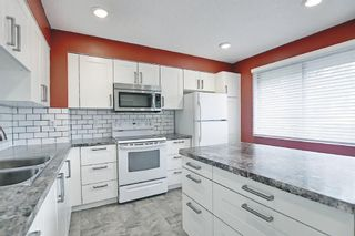 Photo 5: 8 3302 50 Street NW in Calgary: Varsity Row/Townhouse for sale : MLS®# A1120305