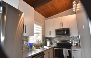 Photo 4: 217 Pinemont Road NE in Calgary: Pineridge Row/Townhouse for sale : MLS®# A1103067