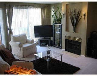 Photo 2: # 402 2915 GLEN DR in Coquitlam: House for sale (Canada)  : MLS®# V758853