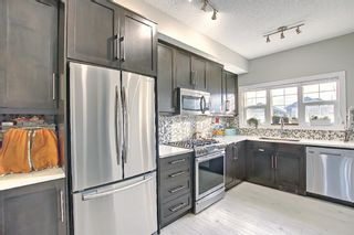 Photo 6: 442 Nolan Hill Boulevard NW in Calgary: Nolan Hill Row/Townhouse for sale : MLS®# A1073162