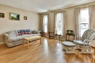 Photo 3: 1916 65 Street NE in Calgary: Pineridge House for sale : MLS®# C4177761