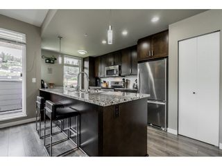 """Photo 8: 410 2242 WHATCOM Road in Abbotsford: Abbotsford East Condo for sale in """"~The Waterleaf~"""" : MLS®# R2372629"""