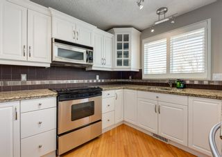 Photo 16: 848 Coach Side Crescent SW in Calgary: Coach Hill Detached for sale : MLS®# A1082611