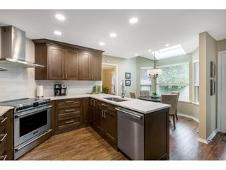 """Photo 12: 118 6109 W BOUNDARY Drive in Surrey: Panorama Ridge Townhouse for sale in """"LAKEWOOD GARDENS"""" : MLS®# R2625696"""